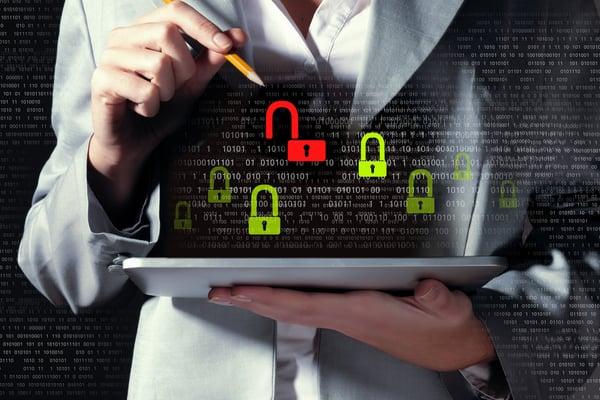 Businesswoman holding tablet pc entering password. Security concept-1